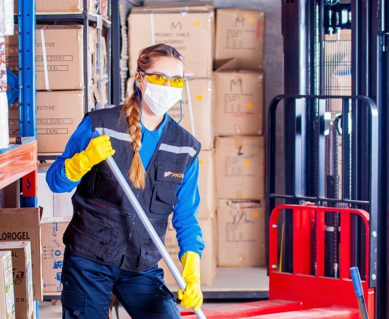 Non-native English speaking employee with safety goggles and mask