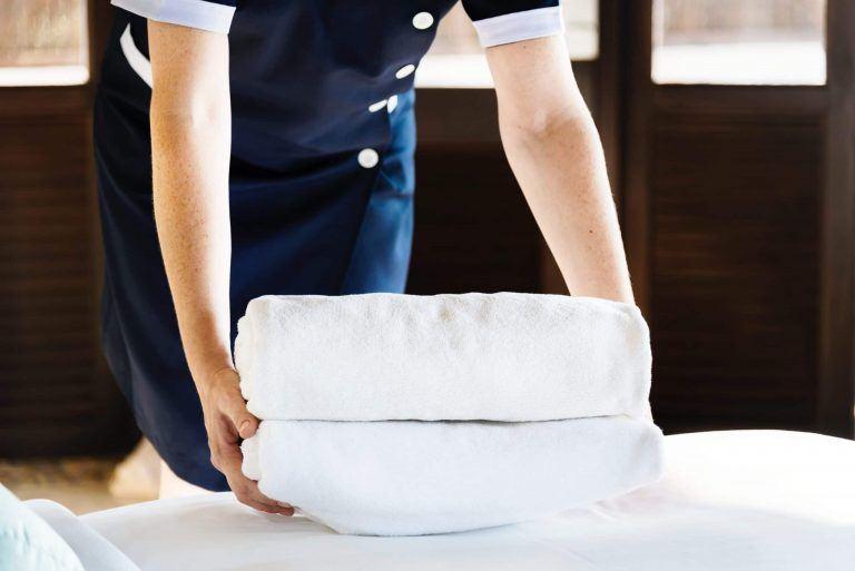 housekeeping hotel employee with bath towels